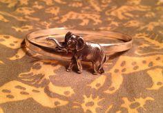 Keep elephants long in the tusk. Gustav Manz sterling bangle. A portion of each sale supports Tusk Trust. #HowToWearAnElephant gustavmanz.com