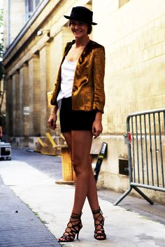 In love with this ensemble! Golden velvet blazer, black short and strappy black shoes.