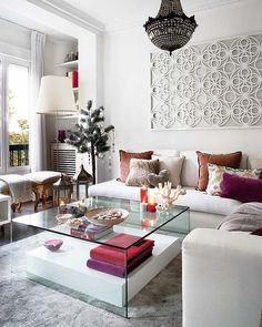 adore this room...coffee table, art over couch and chandelier