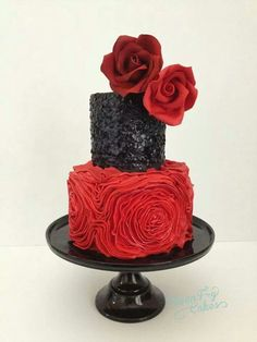 red and Black wedding cake. Would love that first tier rosette done in black