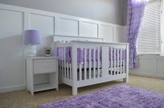 A #white #nursery with pretty pops of #purple.