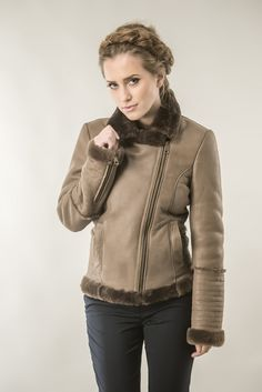 Lambskin coat, designed for women. This jacket can be a very important piece of clothing in your wardrobe, being versatile and modern piece. The exterior of the jacket is a perfect combination of lamb nappa leather, which has important properties like resistance to moisture and dirt, and fur trimmed lamb merino, for a unique look. Inside the jacket of fur it is created from merino lamb fur trimmed to a thickness of 8 mm.