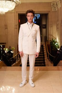 Cameron Dallas looking fresh in an all white Topman suit paired with complementing kicks at the 2016 Met Gala.