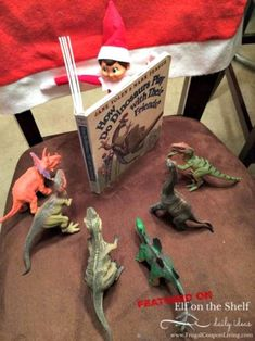elf-on-the-shelf-ideas-elf-reads-to-dinos-frugal-coupon-living We want you! Send us your Funny, Easy, and Creative Elf on the Shelf Ideas. Hundreds of ideas found on Frugal Coupon Living. Christmas Elf, Christmas Humor, Christmas Countdown, Christmas Carol, Christmas Crafts, Modern Christmas, Christmas Activities, Christmas Traditions, Funny Christmas Decorations