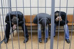 """Scapegoats or suspects? """"Tamerlan Eskerkhanov, Shagid Gubashev and Ramzan Bakhayev (L to R), [all Chechens] detained over the killing of Boris Nemtsov, hide their faces inside a defendants' cage at a court building in Moscow, [today] March 8, 2015. REUTERS-Maxim Shemetov"""""""