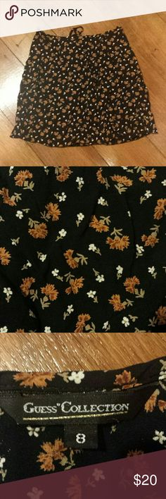 Adorable autumn vintage 90s guess floral skirt Cute authentic 90s guess mini skirt made of thin rayon material. Black with amber orange and white fall flowers. Has a zipper and drawstring. Size says 8 but I think it's smaller. The waist is 13 to 14 inches. Guess Skirts Mini