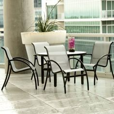 Woodard Tribeca Patio Dining Set - Seats 4 by Woodard. $2049.99. Most would agree - food tastes better in the right setting. Create a comfortable dining atmosphere on your patio with the Woodard Tribeca Patio Dining Set - Seats 4. This all-weather patio set includes four modern dining chairs and a round table with glass or acrylic top. Backed by a five-year fade-resistance warranty, the Sunbrella sling seats are quick-to-dry, making them perfect for poolside us...