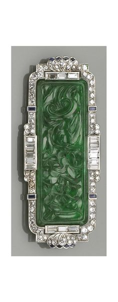 An art deco, jadeite jade, diamond, sapphire, and platinum brooch pendant