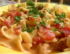 Pasta, tomatoes, italian sausage, and cream. One of my favorite pasta dishes!