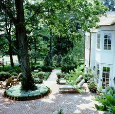 Garden design by interior designer Howard Slatkin, New Jersey countryside. Garden furniture by Melrose House.