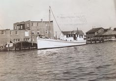 """The """"Hausie B"""", my grandfather's favorite boat. Geo. A. Christy & Son seafood plant in Crisfield, MD. 1945"""