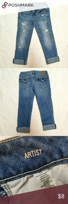 American Eagle Artist Cropped Jeans Lightly Worn American Eagle artist distressed cropped jeans lightly worn size 0. The back pockets feature cute button flaps. These cropped jeans are the perfect length for when you are in between choosing pants or shorts! They were only worn a few times before I grew out of them so they are in great condition. American Eagle Outfitters Jeans Ankle & Cropped