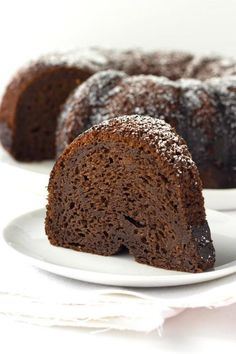 Recipe for Kahlua Cake made in a bundt pan and dusted with powdered sugar. This is an easy, delicious doctored-up cake mix recipe. Kahlua Recipes, Cake Mix Recipes, Pound Cake Recipes, Dessert Recipes, Apple Recipes, Dessert Ideas, Sweet Recipes, Cake Ideas, Yummy Recipes