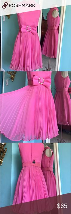 Vintage couture Jack Bryan pink ruffle dress Fabulous True Vintage pink pleated chiffon ruffle hem dress by Jack Bryan of California with rhinestone bow belt! Early 1960's dress in good vintage condition: few minor issues: tiny snags (neck/skirt) small spots and belt needs to be re-glued/cleaned. Dress could be dry cleaned-- I'll leave that to the collector's discretion. Perfect for a dance party, dinner, cosplay or just looking fabulous! Please see pics. The belt fastens but is too small…