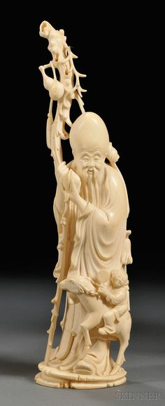Ivory Carving, China, standing figure of Shou Lao with a child and deer, ht. 12 3/8 in.