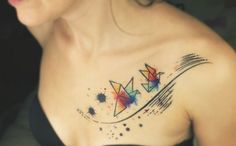 Hints of watercolor in this discreet and feminine tattoo by Aivaras Lee.
