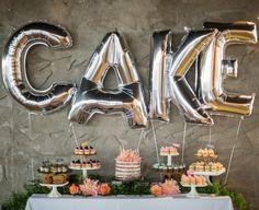 Dessert bar with foil letter balloons.
