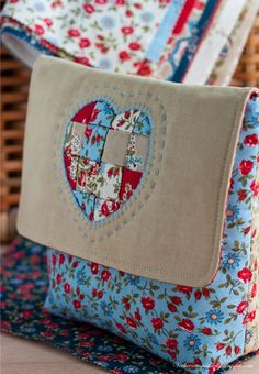 """A cosmetic case. This is interesting, The heart is not patchwork but strips of fabric """"woven"""" into place then secured with outlining embroidery. Patchwork Heart, Patchwork Bags, Quilted Bag, Fabric Crafts, Sewing Crafts, Sewing Projects, Sewing Tutorials, Bag Quilt, Quilt Patterns"""