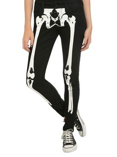 "Skinny jeans from LOVEsick with a black wash and white skeleton design on the front. Classic 5-pocket styling and button and zip fly.<ul><li> 9"" leg opening</li><li>81% cotton; 18% polyester; 1% spandex</li><li>Wash cold; dry low</li><li>Imported</li></ul>"