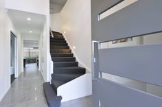 Modern Entry, Hallway and Stair Case by Nuvo Homes