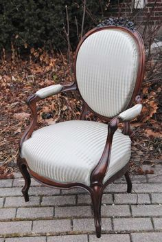For Sale on 1stdibs - Antique European hand-carved rosewood chair with fine hand-carved details. Chair has been newly upholstered in a Scalamandre silk stripe in soft blue and