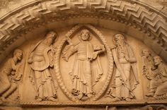 The Transfiguration of Christ with Moses and Elijah, watched by the apostles Peter, James and John. Detail of second Romanesque tympanum from the west facade, 12th century, now protected inside the church. La Charité-sur-Loire, Burgundy, France.