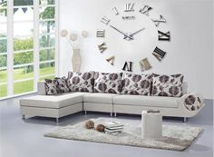 http://trainingjo.com/wp-content/uploads/2014/10/natural-living-room-design-with-floral-pillow-on-sectional-white-sofa-and-white-fur-rug-without-table-along-with-clock-design-on-the-wall-and-glass-window.jpg