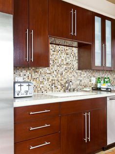 Energize a kitchen with a backsplash design that sets the room in motion. A…