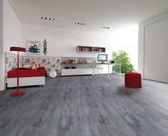 Love the grey wood floors and red accents!