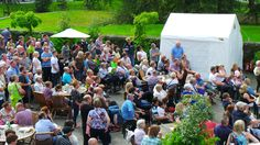 Crowds gathered to watch a talk about 'Extreme Chilli's' at the Holker Chilli Fest 2014.