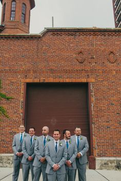 Gray suits for groom and groomsmen from a garden romance wedding at the Cultural Arts Center in Columbus Ohio from Jessica Love Photography. More http://www.theknot.com/submit-your-wedding/photo/f65dd516-a3dc-469d-9b24-fe4bd6d99c64/Elizabeth-and-Justin-garden-romance-wedding
