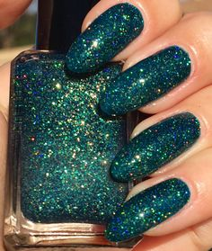 This is a tease/green crelly polish with gold holographic micro glitters. The swatches show two coats with top coat. Full size, 5 free, hand mixed polish.