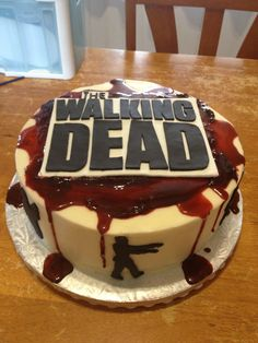 The Walking Dead Cake I made. Inspiration from Pinterest. Fondant zombies, buttercream and corn syrup. Made by Emily Barnes-Foley.