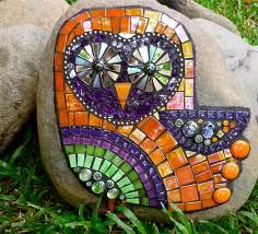 mosaic owl on rock