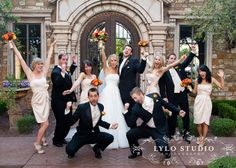 Beige bridesmaids dresses with orange and red bouquets | Lylo Studio Photography | villasiena.cc