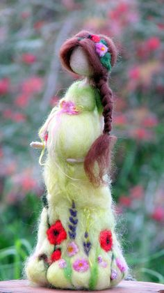 Needle felted Waldorf inspired standing doll. She is tall about 9, her dress made out of soft merino and silk. Decorated with flowers. Ready to ship now. Thank you for visiting my shop!! Please see my shop policies for more information: http://www.etsy.com/shop/Made4ubymagic/policy