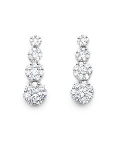 With a supple and simple floral design in round cut cubic zirconia, these earrings dance freely with elegance as they dangle from the ear.    $49.00