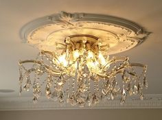 A luxurious Maria Theresa ceiling light fitting, made by hand in Italy, with 6 lights.