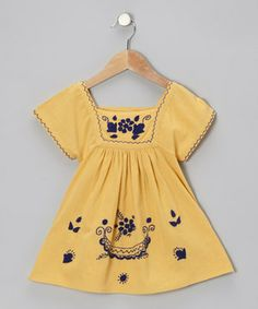 Soft, delightful and fun to wear, this sweet tunic features contrast stitching and beautiful knit embellishments. Add in the square-neck pullover design and tiny tulips will be petal pickin' in no time.
