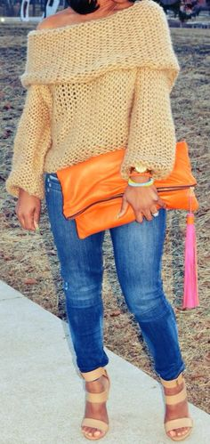 Cute outfit....not the shoes. The sweater & clutch are amazing !!!
