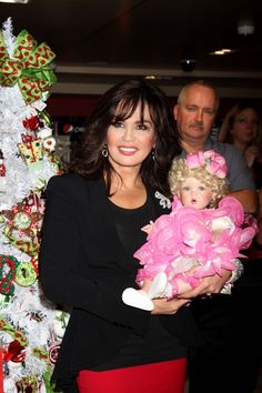 Marie Osmond holding one of her dolls.....