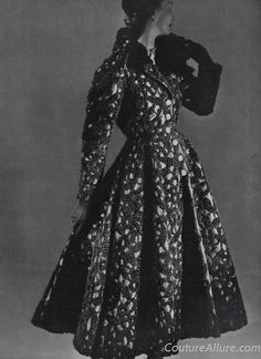 For Fall 1948, Balenciaga designed this incredible coat in black silk faille covered in elaborate embroidery.