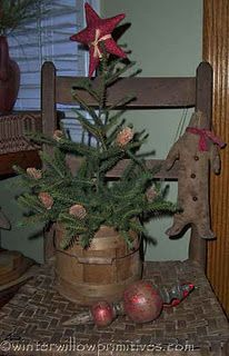 love this lil primitive tree! I have 1 similar to it w lil star lights!