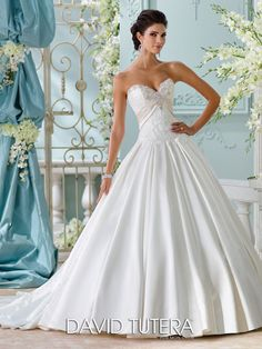 David Tutera for Mon Cheri - 116200 – Heloise - Strapless soft satin and embroidered Schiffli lace appliqué ball gown, sweetheart neckline adorned with jeweled encrusted hand-beading, lace appliquéd bodice features pleated satin inverted empire band, dropped waist, covered buttons down back bodice, box pleated full skirt with concealed side pockets, chapel length train, detachable spaghetti and halter straps included.Sizes: 0 – 20Colors: Ivory/Alabaster Ivory, White