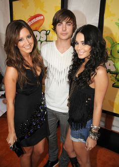 If you thought the High School Musical crew was back together based on Ashley Tisdale's Instagram photo, think again! She didn't reunite together with Zac Efron and Vanessa Hudgens — that was all Photoshop. At least we can reminisce with old throwback pics...