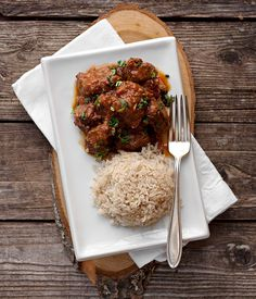 warm spiced beef curry with rice: boneless stewing beef, vegetable oil, onions, garlic, cinnamon, bay leaf, dried crushed red pepper, whole milk, canned peeled tomatoes, Major Grey chutney, fresh lemon juice, fresh ginger, mild curry powder, salt, and rice