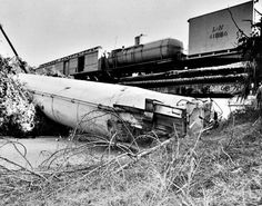 Louisville and Nashville freight train derails at the 17th Avenue trestle and anhydrous ammonia kills two and injures 46 as they try to flee the toxic gas cloud (1977)