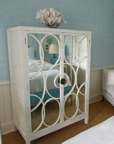 Glue each piece of mirror to the door....then glue curved pieces of wood onto mirror.  Easy diy!...maybe embroidery hoops