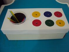Matching colored straws/sticks to the hole. Supports color matching and fine motor skills.