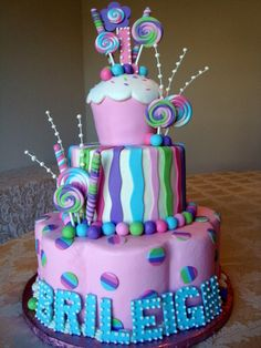 Cupcake cake with lolipops by Let There Be Cake, via Flickr
